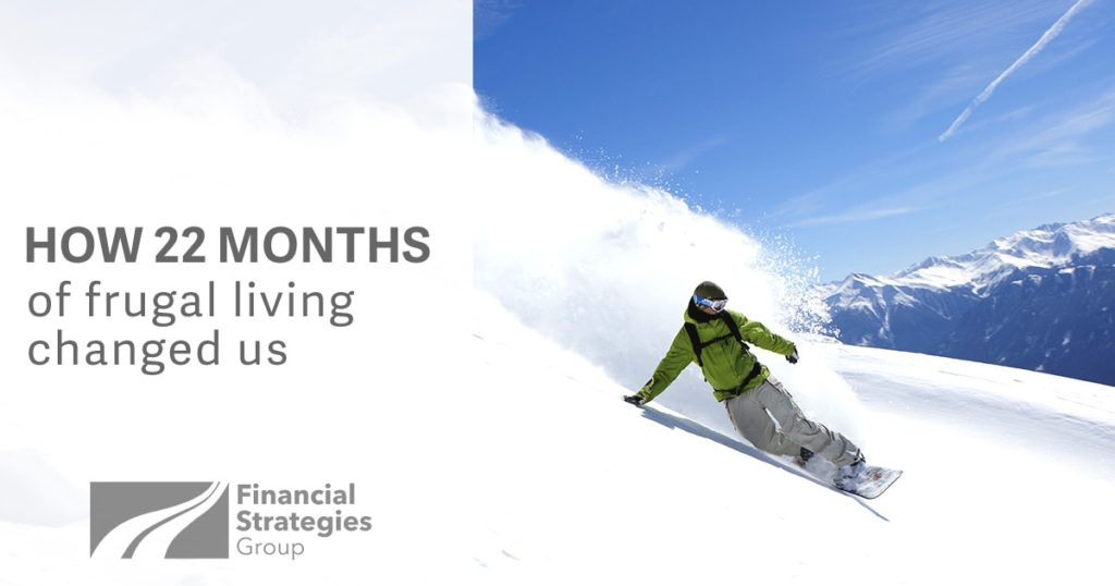 How 22 Months of Frugal Living Changed Us - snowboarder on a mountain - living the dream - racking up debt